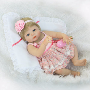 silicone-full-body-reborn-baby-doll-girl-banydoll-lying on bed