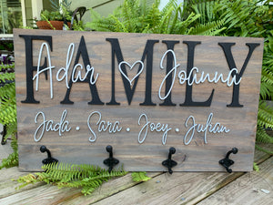 Family name sign with hooks