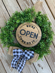 Boxwood wreath with reversible signs