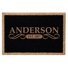 Black doormat with tan border and name and date centered