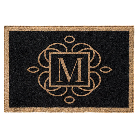 black doormat with tan border and initial centered