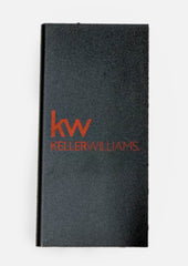 rectangular black portable usb charger with red Keller Williams logo