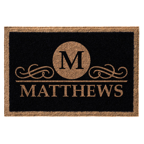 black doormat with tan border, name and initial