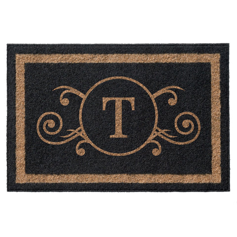 black and tan doormat with initial centered flourish