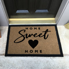 tan doormat with black border and Home Sweet Home in black on porch