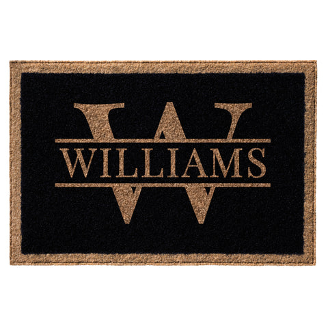 black and tan doormat with family name over initial