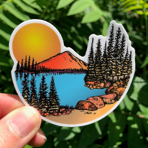 Sunset in the mountains with a sky blue lake sticker