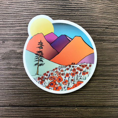mountains and a field of poppies. brightly colored vinyl sticker
