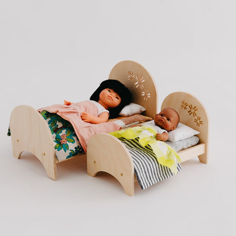 dolls in pine crafted beds