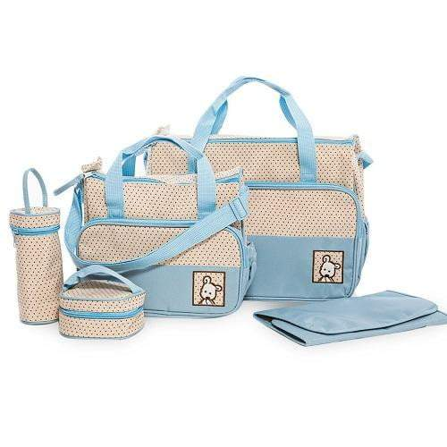 A blue and white baby bag set with polka dots. This set includes a large nappy bag, a medium nappy bag, a bottle warmer, lunchbox and changing mat.