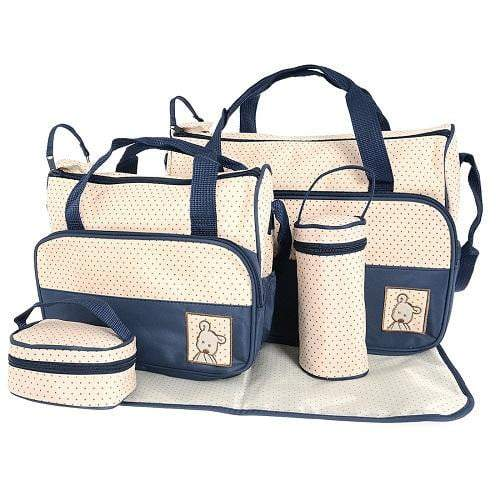 A navy and white baby bag set with polka dots. This set includes a large nappy bag, a medium nappy bag, a bottle warmer, lunchbox and changing mat.