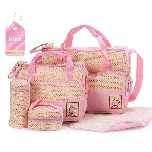 A pink baby bag set with polka dots. This set includes a large nappy bag, a medium nappy bag, a bottle warmer, lunchbox and changing mat.