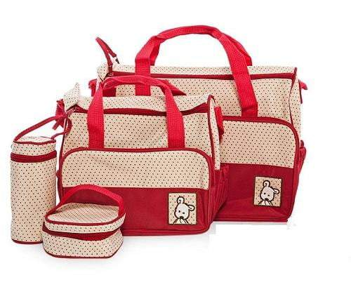 A red and white baby bag set with polka dots. This set includes  a large nappy bag, a medium nappy bag, a lunchbox and bottle warmer.