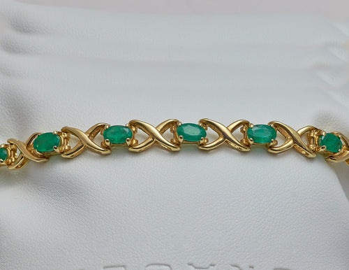 14k yellow gold Emerald and Gold link bracelet
