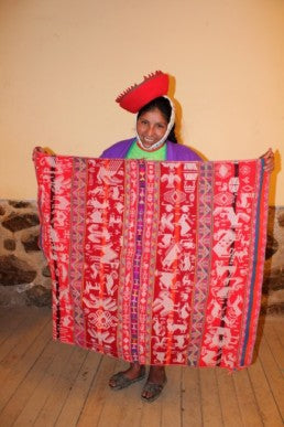 Andean woman and her handmade blanket