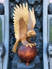 American Eagle Perched on Globe