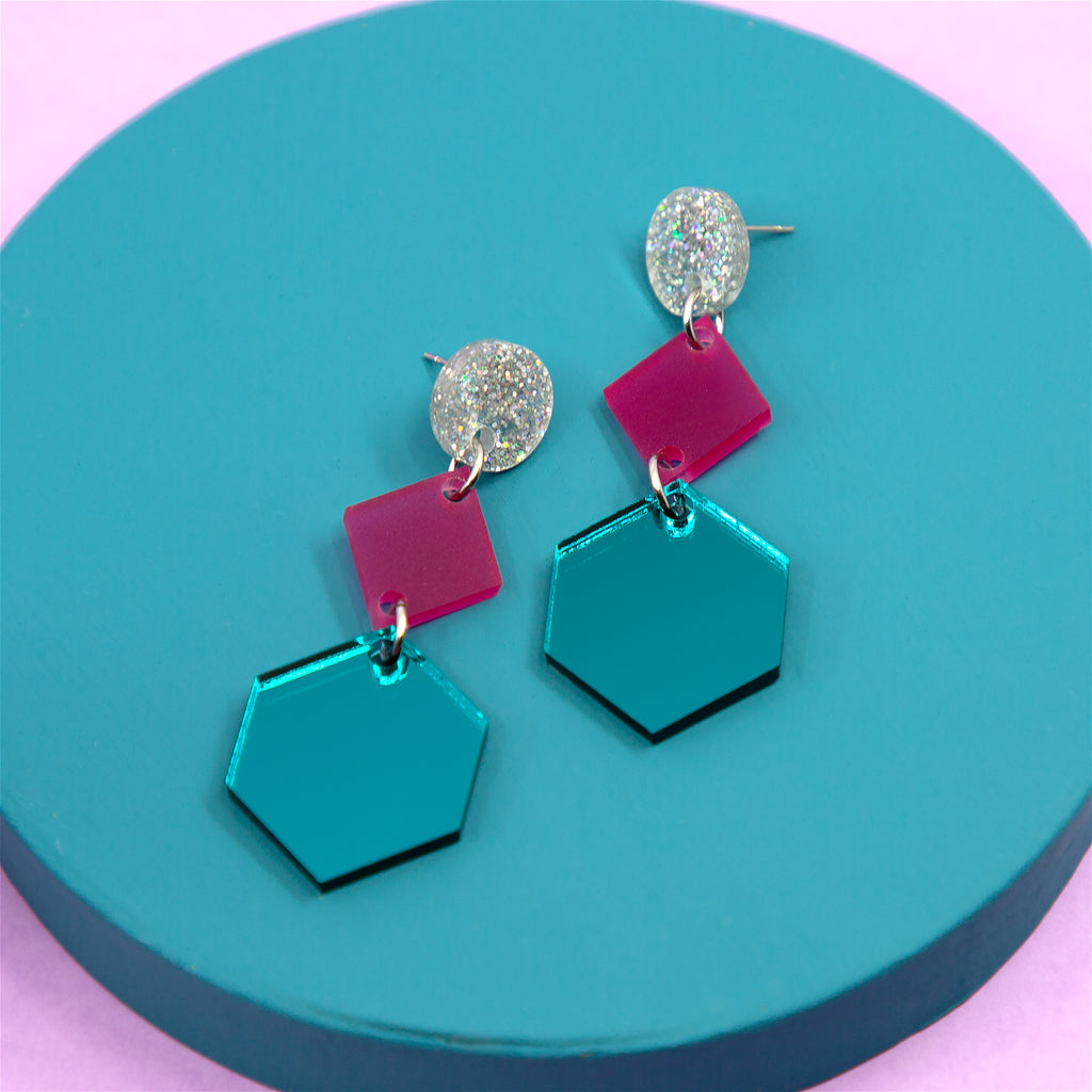 PHOEBE NO.2 IN SILVER GLITTER, FROSTED MAGENTA & TEAL MIRROR. ACRYLIC EARRING