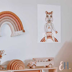 Mr Quinn Quokka sitting on a boho Rainbow art print for nurseries by Australian Artist Elyse Howlett. Styled by Margaux from TheFrenchFolk and Dreamy Spaces Magazine