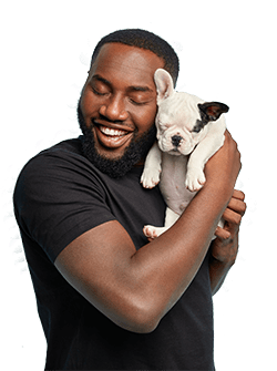 Man Cuddling Little Black And White Dog