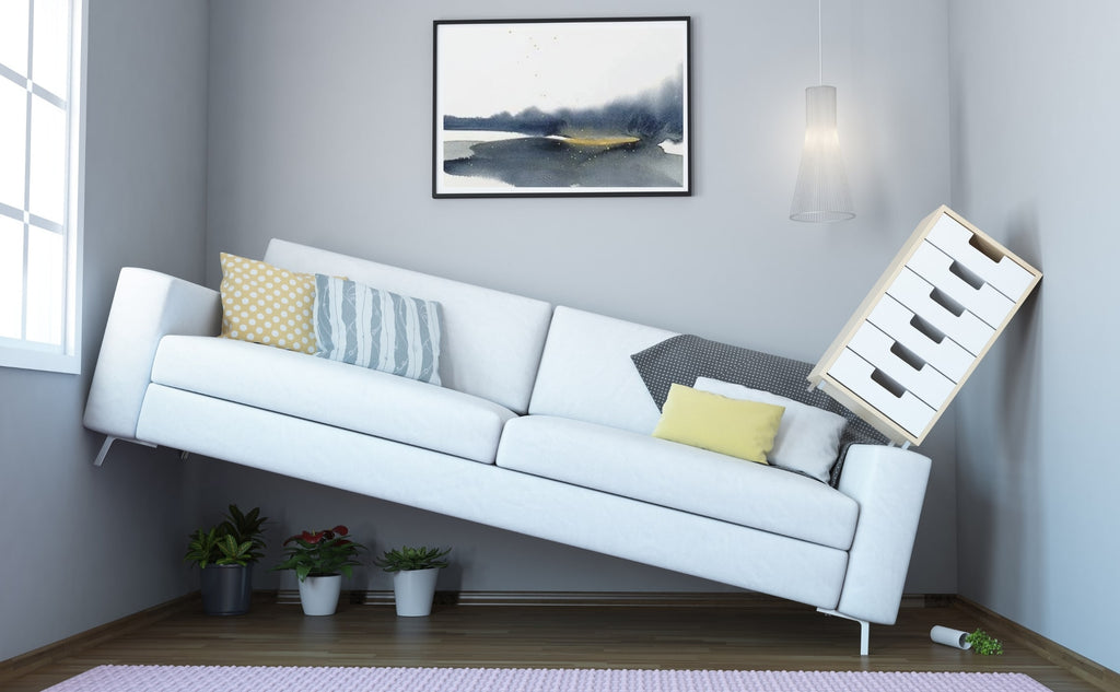 "Large sofa crammed into a narrow room on an angle, ""How to Make A Narrow Room Look Wider"", from Estilo Living Blog"