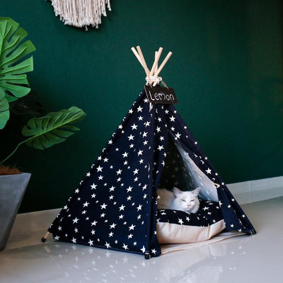 White cat sleeping in Navy Blue with White Stars Canvas Cotton Modern Boho Cat Teepee with Plush Cat Bed Cushion, from Pet Teepees and Pet Accessories Collection, at Estilo Living