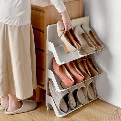 Person storing shoes in Light Gray Shoe Storage & Organizer Rack, Shoe Racks Storage Collection, from Estilo Living