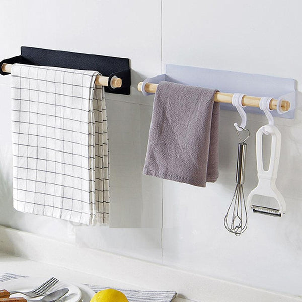 Two White and Black the Lindsay Towel Rack & Paper Towel Holders in the kitchen, from Estilo Living