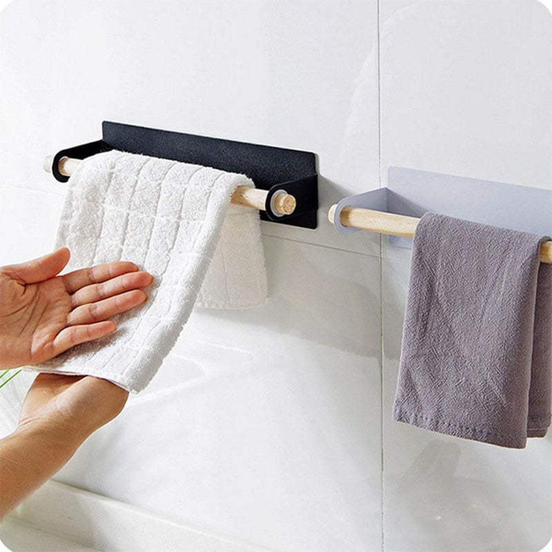 White and Black the Lindsay Towel Rack & Paper Towel Holder with hand towels in the bathroom, from Estilo Living