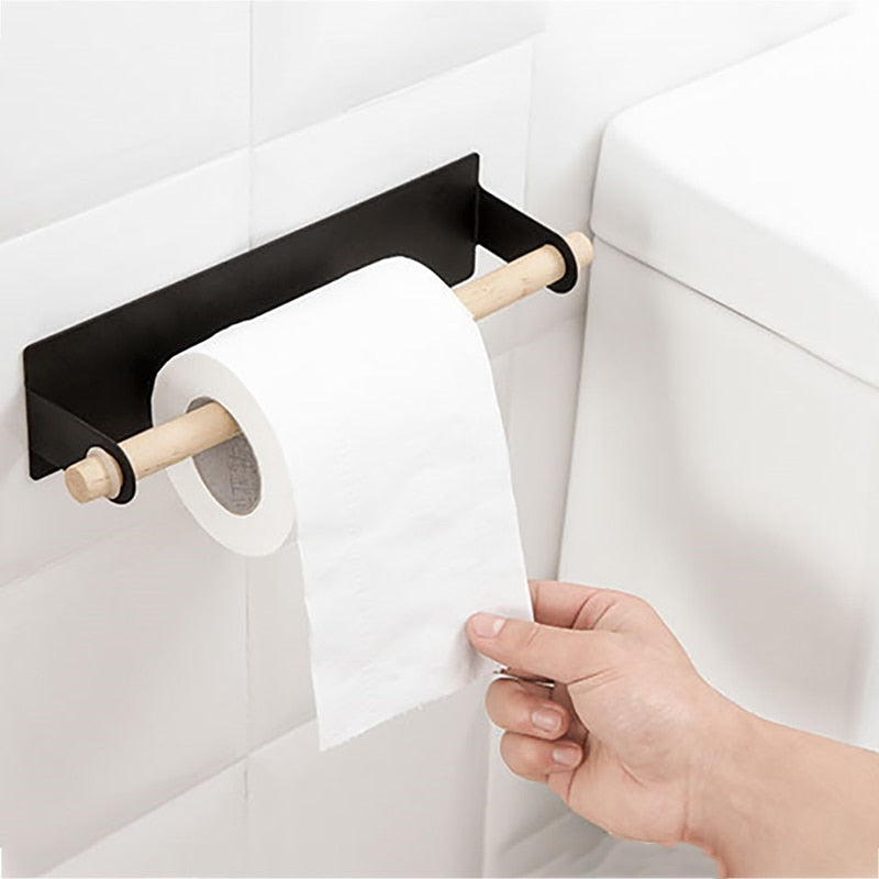 Black color the Lindsay Towel Rack & Paper Towel Holder with toilet roll hanging in bathroom, from Estilo Living