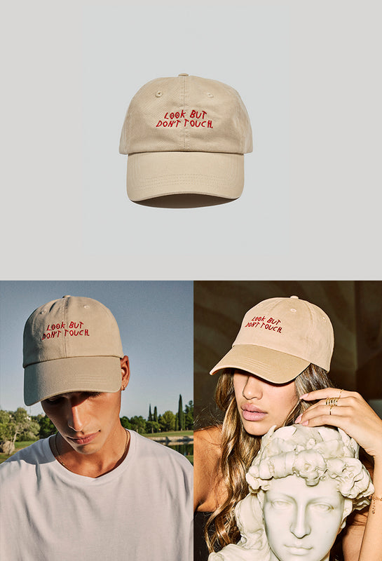 Look but don't touch a couple wearing matching baseball caps instagram outfit look inspiration from Spain Marbella