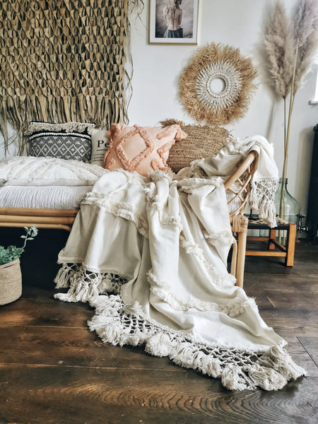 A beautiful textured throw with ruffles and tassels
