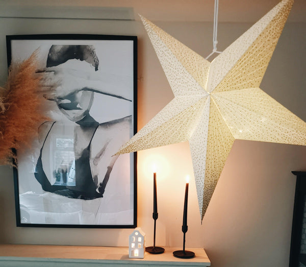 white & gold hanging star