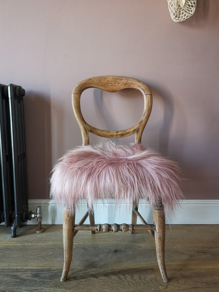 Rose pink sheepskin chair cover