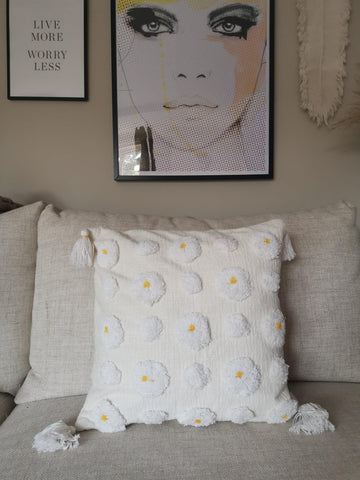 A natural on trend white tassle cushion cover