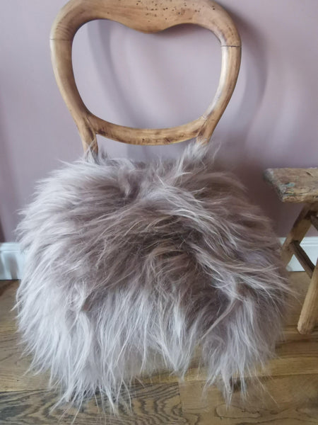 Pink sheepskin cover