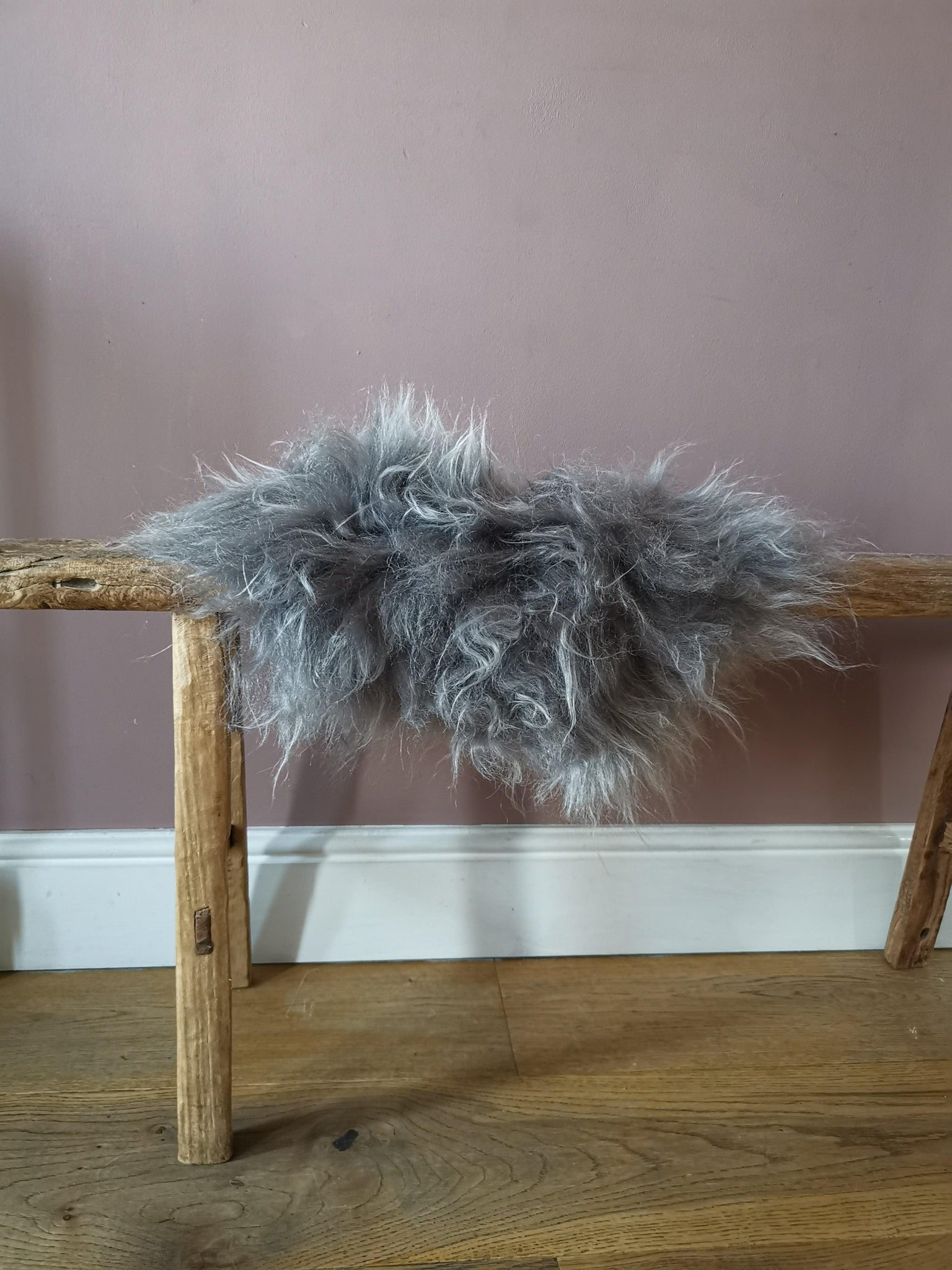 Grey sheepskin fur stool cover round