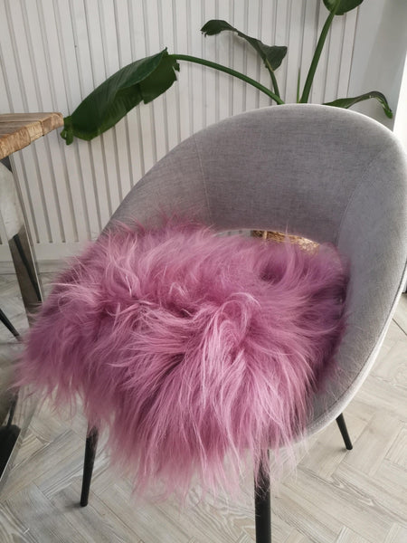 Deep pink sheepskin chair cover