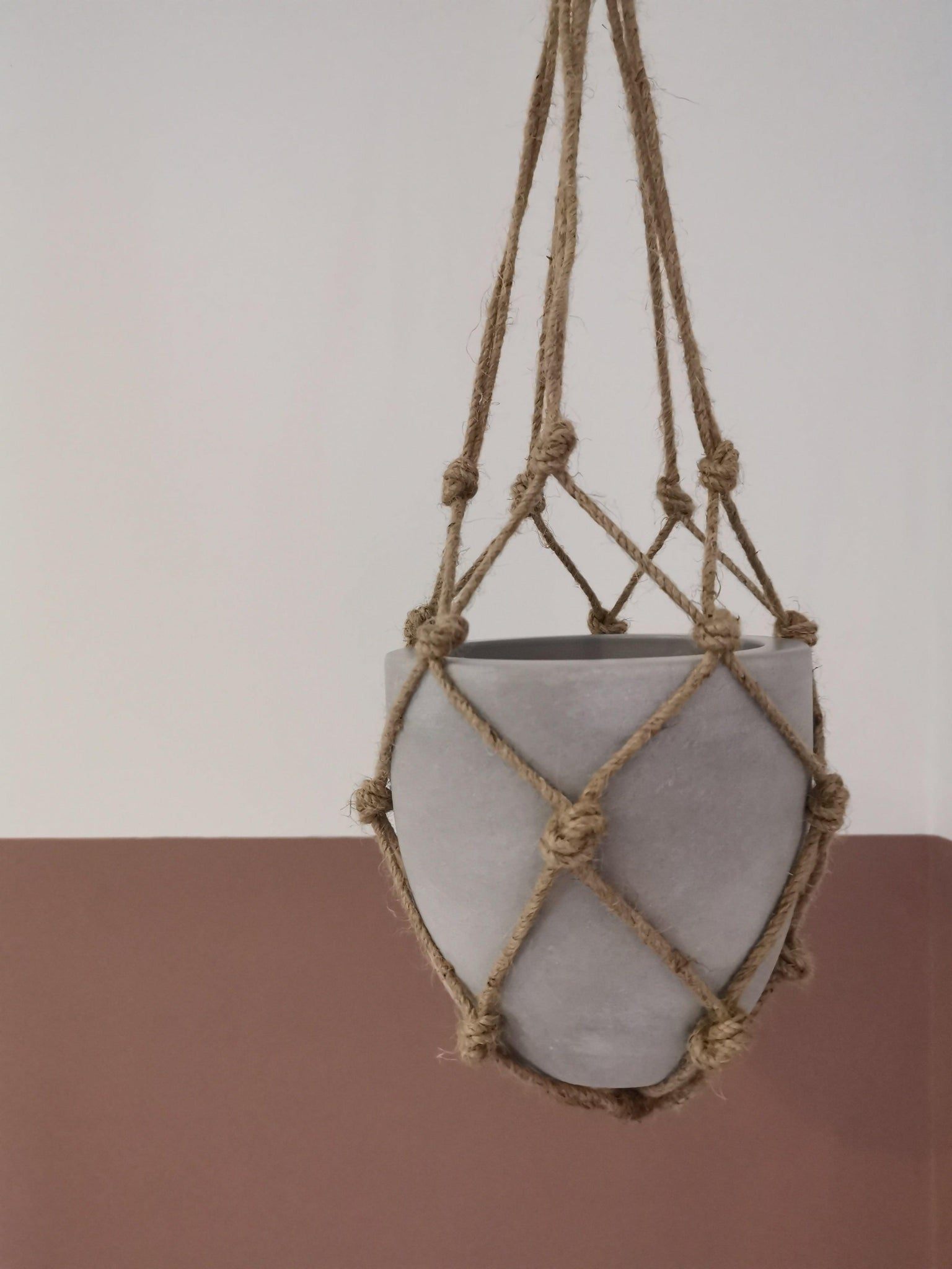 Jute plant hanger with concrete pot
