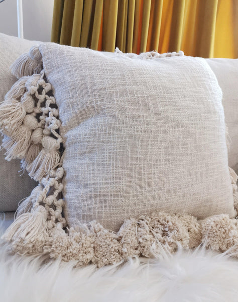 A natural on trend cream tassle cushion cover