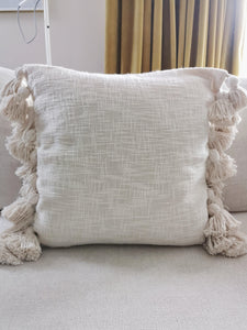 Tassled cream cushion cover