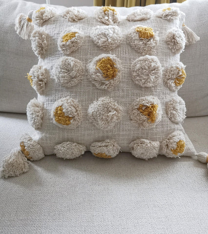 A natural on trend and mustard cream pom pom cushion cover