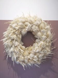 Natural dried bleached grass and thistle wreath