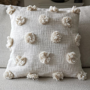 A natural on trend cream pom pom cushion cover