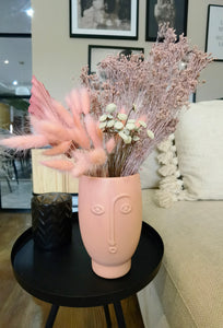 Pink face vase with small bouquet