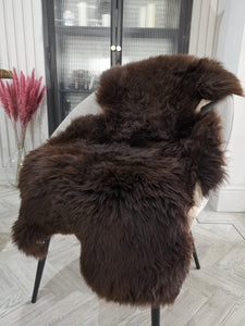 A beautiful natural rare breed sheepskin rug in deep brown..Benji