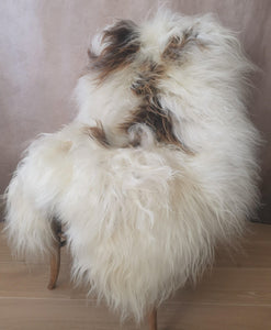 A natural XL brown and white genuine soft luxury sheepskin rug