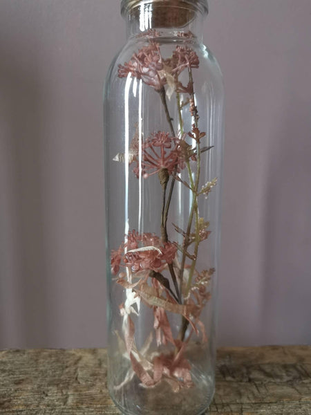 A beautiful corked bottle with dried look flowers
