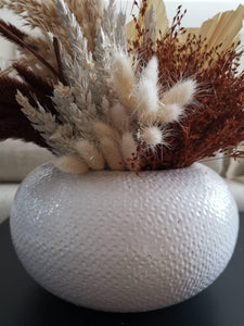 A stylish white textured vase