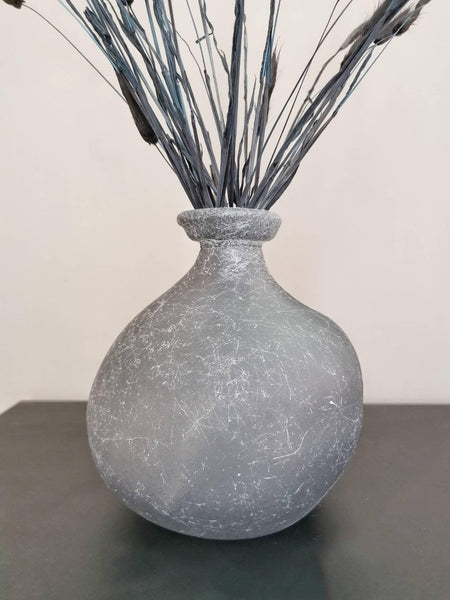 A beautiful organic bottle neck grey vase