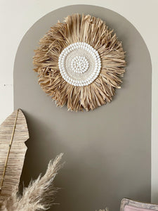 Large round shell and raffia wallhanging